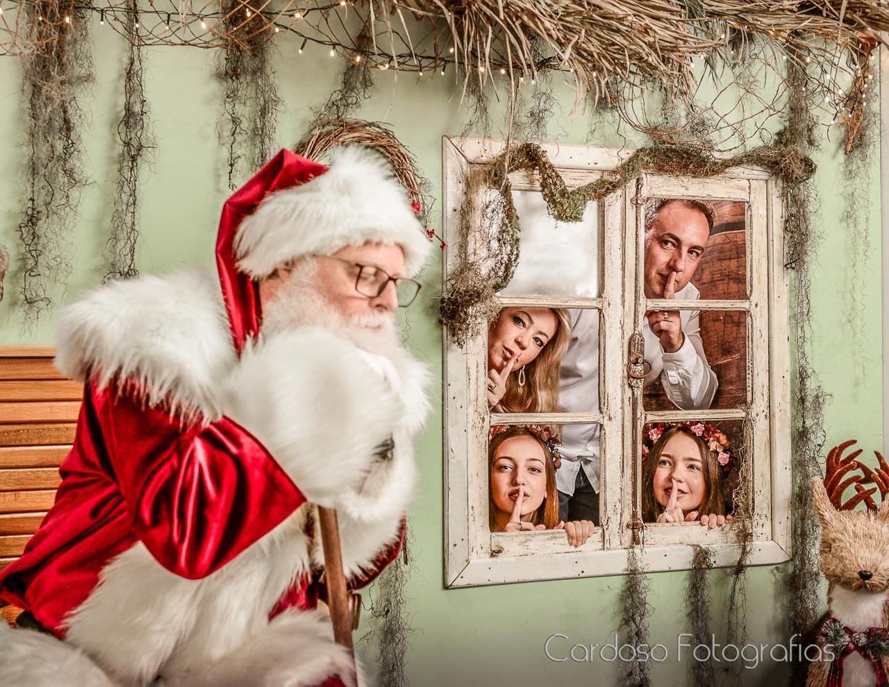 fotografia com o papai noel em família em Blumenau