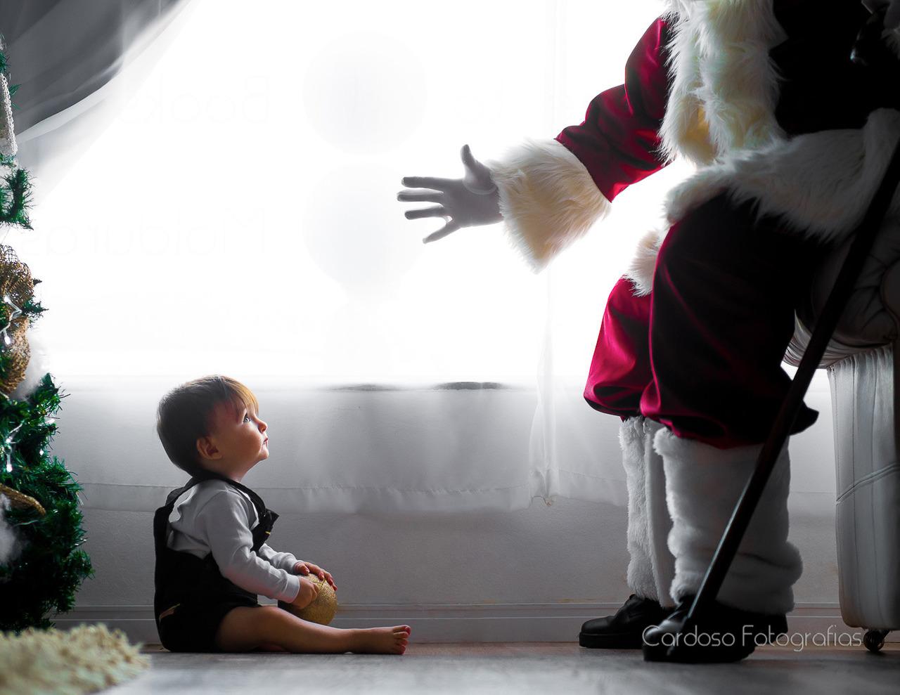 Acompanhamento Mensal de bebê com ensaio fotográfico de Natal com o Papai Noel