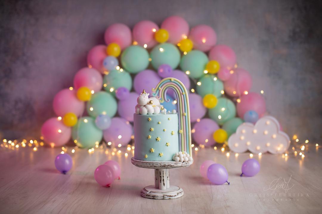 ensaio de bebê bolo smash the cake unicornio arco-íris